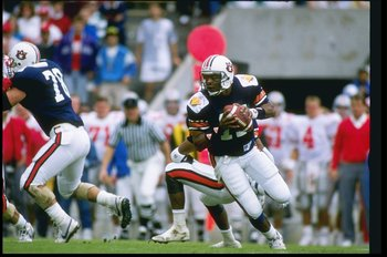 1990:  Quarterback Reggie Slack of the Auburn Tigers rolls out of the pocket during a game against the Ohio State Buckeyes at the Hall of Fame Bowl in Florida.  Auburn won the game 31-14. Mandatory Credit: Scott Halleran  /Allsport