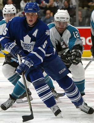 TORONTO - DECEMBER 3:  Alyn McCauley #10 and Patrick Marleau #12 both of the San Jose Sharks skate after Tomas Kaberle #15 of the Toronto Maple Leafs on December 3, 2005 at the Air Canada Centre in Toronto, Ontario, Canada. The Sharks beat the Leafs 5-4.