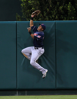 ANAHEIM, CA - SEPTEMBER 08:  Center fielder Michael Brantley #23 of the Cleveland Indians jumps to catch a ball at the wall and deny a bid for a walk off home run by Juan Rivera #20 of the Los Angeles Angels of Anaheim in the tenth inning on September 8,