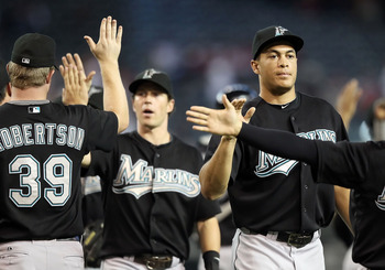 PHOENIX - JULY 11:  Mike Stanton #27 of the Florida Marlins high fives teammates after defeating the Arizona Diamondbacks in the Major League Baseball game at Chase Field on July 11, 2010 in Phoenix, Arizona.  The Marlins defeated the Diamondbacks 2-0.  (