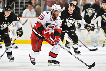 PITTSBURGH - NOVEMBER 19:  Erik Cole #26 of the Carolina Hurricanes skates with the puck against the Pittsburgh Penguins n November 19, 2010 at Consol Energy Center in Pittsburgh, Pennsylvania.  (Photo by Jamie Sabau/Getty Images)