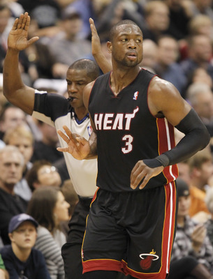 SALT LAKE CITY, UT - DECEMBER 8: Dwyane Wade #3 of the Miami Heat gestures a three after making a three point shot in a game against the Utah Jazz during the second half of an NBA game December 8, 2010 at Energy Solutions Arena in Salt Lake City, Utah. Th