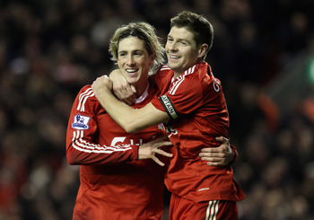 LIVERPOOL, ENGLAND - DECEMBER 16:   Fernando Torres of Liverpool is congratulated by team mate Steven Gerrard (R) after scoring his team's second goal during the Barclays Premier League match between Liverpool and Wigan Athletic at Anfield on December 16,