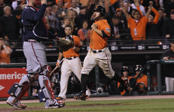 SAN FRANCISCO - OCTOBER 08:  Cody Ross #13 of the San Francisco Giants scores a run off of a base hit by Matt Cain (not shown) during the second inning of the National League Division Series with the Atlanta Braves at AT&amp;T Park on October 8, 2010 in San F