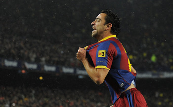 BARCELONA, SPAIN - NOVEMBER 29:  Xavi Hernandez of Barcelna celebrates after scoring the first goal during the La Liga match between Barcelona and Real Madrid at the Camp Nou Stadium on November 29, 2010 in Barcelona, Spain.  Barcelona won the match 5-0.