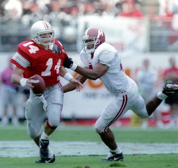 2 JAN 1994:  OHIO STATE QUARTERBACK BOBBY HOYING IS GRABBED BY ALABAMA DEFENSIVE END DARRELL BLACKBURN DURING THEIR GAME IN THE 1995 CITRUS BOWL AT THE CITRUS BOWL IN ORLANDO, FLORIDA. Mandatory Credit: Andy Lions/ALLSPORT