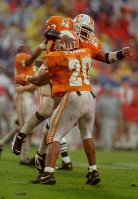 1 JAN 1996:  CRAIG KING #44 OF TENNESSEE CELEBRATES AS HE JUMPS INTO THE ARMS OF TEAMMATE CHESTER FORD #20 AFTER KING RECOVERED A FUMBLE IN THE FOURTH QUARTER OF THE COMP USA FLORIDA CITRUS BOWL AGAINST OHIO STATE AT THE CITRUS BOWL IN ORLANDO.  TENNESSEE
