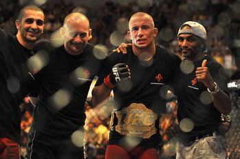LAS VEGAS - JULY 11:  (2nd R) Georges St. Pierre celebrates his victory against Thiago Alves during their welterweight title bout during UFC 100 on July 11, 2009 in Las Vegas, Nevada. St. Pierre defeated Alves by unanimous decision.  (Photo by Jon Kopalof