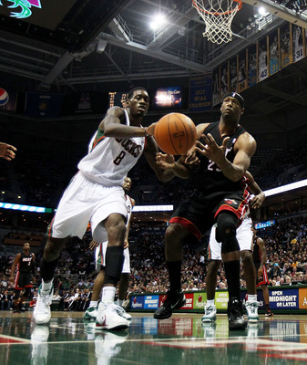 MILWAUKEE, WI - DECEMBER 06: Erick Dampier #25 of the Miami Heat and Larry Sanders #8 of the Milwaukee Bucks moves toward a loose ball at the Bradley Center on December 6, 2010 in Milwaukee, Wisconsin. The Heat defeated the Bucks 88-78. NOTE TO USER: User