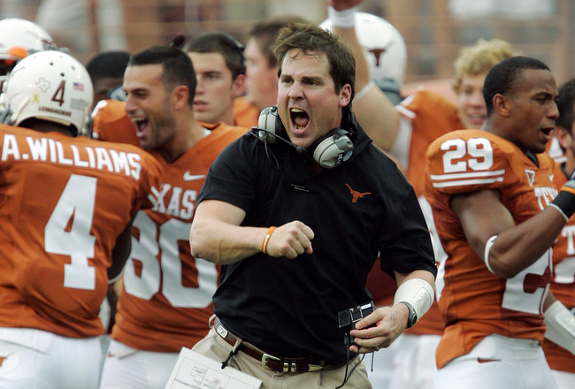AUSTIN, TX - SEPTEMBER 5:  Defensive coordinator Will Muschamp of the Texas Longhorns gets pumped up after a turnover by the Louisiana Monroe Warhawks in the first quarter on September 5, 2009 at Darrell K Royal-Texas Memorial Stadium in Austin, Texas.  (