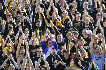 IOWA CITY, IA - OCTOBER 30- University of Iowa Hawkeyes fans cheer on their team during play against the Michigan State Spartans at Kinnick Stadium on October 30, 2010 in Iowa City, Iowa. Iowa won 37-6 over Michigan State. (Photo by David Purdy/Getty Imag