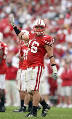 ORLANDO, FL - JANUARY 01: Joe Stellmacher #16 of the Wisconsin Badgers motions on the field against the Arkansas Razorbacks in the Capitol One Bowl at Florida Citrus Bowl on January 1, 2007 in Orlando, Florida. (Photo by Doug Benc/Getty Images)
