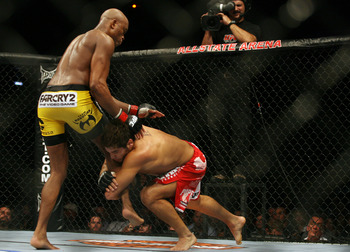 CHICAGO- OCTOBER 25: Anderson Silva (L) wrestles with Patrick Cote  in the Middleweight Title Bout at UFC's Ultimate Fight Night at Allstate Arena on October 25, 2008 in Chicago, Illinois. (Photo by Tasos Katopodis/Getty Images)