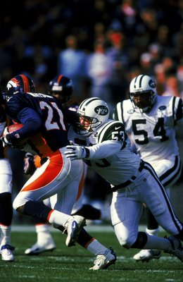 3 Oct 1999: Chad Cascadden #53 of the New York Jets tries to tackle Chris Watson #21 of the Denver Broncos during the game at the Mile High Stadium in Denver, Colorado. The Jets defeated the Broncos 21-13.