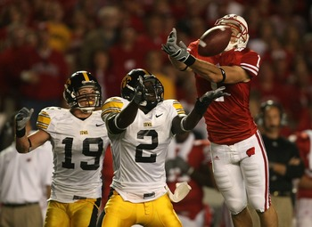 MADISON, WI - SEPTEMBER 22:  Luke Swan #1 of the Wisconsin Badgers misses a catch as Harold Dalton #2 and Adam Shada #19 of the Iowa Hawkeyes defend at Camp Randall Stadium September 22, 2007 in Madison, Wisconsin.  (Photo by Jonathan Daniel/Getty Images)