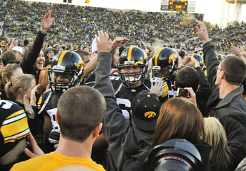IOWA CITY, IA - OCTOBER 30:  University of Iowa Hawkeyes players celebrate with fans after they defeated the Michigan State Spartans at Kinnick Stadium on October 30, 2010 in Iowa City, Iowa. Iowa won 37-6 over Michigan State. (Photo by David Purdy/Getty