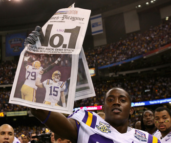 NEW ORLEANS - JANUARY 07:  Terrance Toliver #80 of the Louisiana State University Tigers holds up a newspaper in celebration after defeating the Ohio State Buckeyes 38-24 in the AllState BCS National Championship on January 7, 2008 at the Louisiana Superd