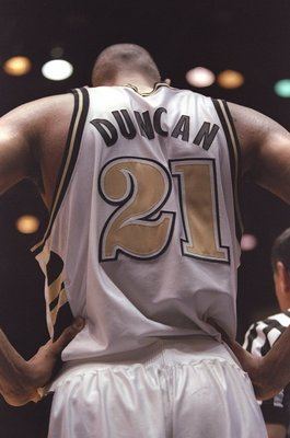16 Mar 1997:  Center Tim Duncan of the Wake Forest Demon Deacons hold his head down a playoff game against the  Stanford Cardinals at the McKale Center in Tuscon, Arizona .  The Cardinals won the game 72 - 66. Mandatory Credit: Brian Bahr  /Allsport