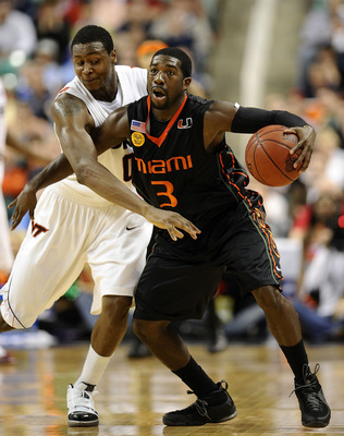 GREENSBORO, NC - MARCH 12:  Jeff Allen #00 of the Virginia Tech Hokies guards Malcolm Grant #3 of the University of Miami Hurricanes in their quarterfinal game in the 2010 ACC Men's Basketball Tournament at the Greensboro Coliseum on March 12, 2010 in Gre
