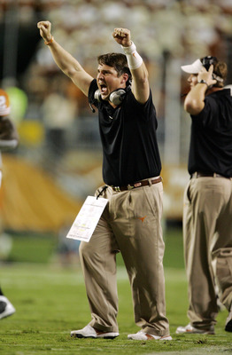 AUSTIN, TX - OCTOBER 18: Defensive coordinator Will Muschamp of the Texas Longhorns celebrates a touchdown against the Missouri Tigers in the second quarter on October 18, 2008 at Darrell K Royal-Texas Memorial Stadium in Austin, Texas. (Photo by Brian Ba