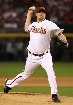 PHOENIX - APRIL 06:  Starting pitcher Brandon Webb #17 of the Arizona Diamondbacks throws the first pitch of the MLB openning day game against the Colorado Rockies at Chase Field on April 6, 2009 in Phoenix, Arizona.  (Photo by Christian Petersen/Getty Im