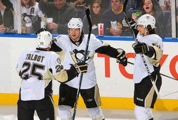 BUFFALO, NY - DECEMBER 11: Maxime Talbot #25, Arron Asham #45 and Kris Letang #58 of the Pittsburgh Penguins celebrate Asham's goal in the first period against the Buffalo Sabres  at HSBC Arena on December 11, 2010 in Buffalo, New York.  (Photo by Rick St