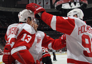 NEWARK, NJ - DECEMBER 11: Pavel Datsyuk #13 of the Detroit Red Wings is congratulated by Tomas Holmstrom #96 on his goal at 10:26 of the third period against the New Jersey Devils at the Prudential Center on December 11, 2010 in Newark, New Jersey. The Re