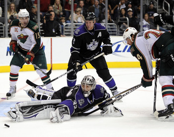 LOS ANGELES, CA - DECEMBER 11:  Jonathan Quick #32 of the Los Angeles Kings makes a save on Martin Havlat #24 of the Minnesota Wild as Matt Greene #2 and Andrew Brunette #15 look for a rebound during the third period at the Staples Center on December 11,