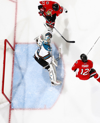 OTTAWA, ON - DECEMBER 02:  Antti Niemi #31 of the San Jose Sharks makes a glove save with Alex Kovalev #27 of the Ottawa Senators swats at the puck in a game at Scotiabank Place on December 2, 2010 in Ottawa, Ontario, Canada.  (Photo by Phillip MacCallum/