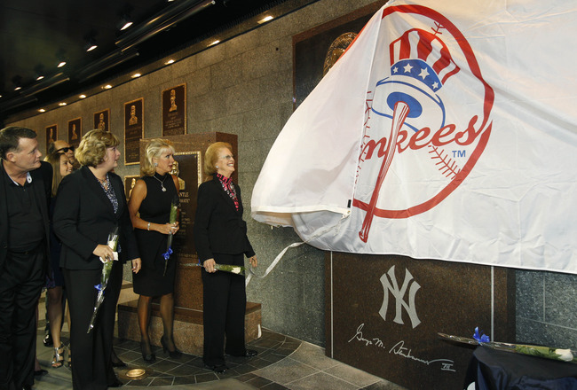 NEW YORK - SEPTEMBER 20:  Members of the Steinbrenner family watch as Steinbrenner's widow Joan pulls a Yankees banner down to reveal  a monument to the late Yankees principal owner George Steinbrenner during a dedication ceremony before the Yankees baseb