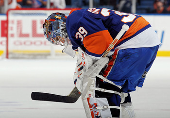 UNIONDALE, NY - DECEMBER 11: Rick DiPietro #39 of the New York Islanders looks on during a time out late in the game agianst the Atlanta Thrashers on December 11, 2010 at Nassau Coliseum in Uniondale, New York. The Thrashers defeated the Isles 5-4.  (Phot