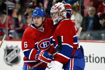 MONTREAL- DECEMBER 4:  Jaroslav Spacek #6 celebrates with Carey Price #31 of the Montreal Canadiens after defeating the San Jose Sharks during the NHL game at the Bell Centre on December 4, 2010 in Montreal, Quebec, Canada.  The Canadiens defeated the Sha