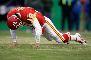 KANSAS CITY, MO - DECEMBER 06:  Quarterback Brodie Croyle #12 of the Kansas City Chiefs is slow to get up after being hit during the game against the Denver Broncos on December 6, 2009 at Arrowhead Stadium in Kansas City, Missouri.  (Photo by Jamie Squire