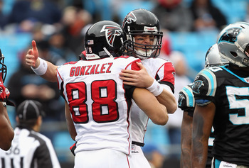 CHARLOTTE, NC - DECEMBER 12:  Matt Ryan #2 of the Atlanta Falcons celebrates with teammate Tony Gonzalez #88 after a touchdown against the Carolina Panthers during their game at Bank of America Stadium on December 12, 2010 in Charlotte, North Carolina.  (