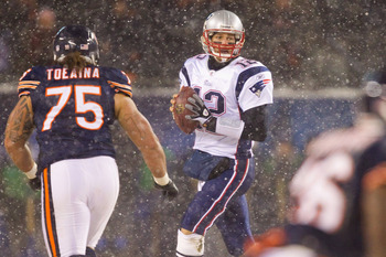 CHICAGO, IL - DECEMBER 12: Tom Brady #12 of the New England Patriots looks to pass against the Chicago Bears at Soldier Field on December 12, 2010 in Chicago, Illinois.  The Patriots beat the Bears 36-7.  (Photo by Dilip Vishwanat/Getty Images)