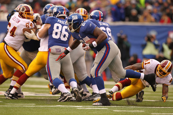 EAST RUTHERFORD, NJ - DECEMBER 05:  Brandon Jacobs #27 of the New York Giants runs with the ball  against the Washington Redskins during their game on December 5, 2010 at The New Meadowlands Stadium in East Rutherford, New Jersey.  (Photo by Al Bello/Gett
