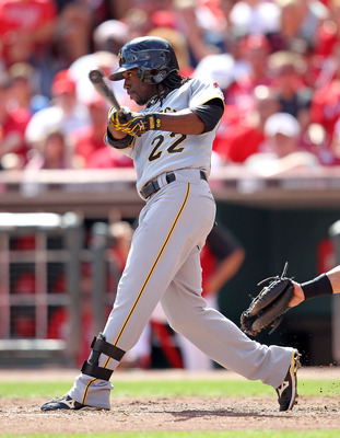 CINCINNATI - SEPTEMBER 12:  Andrew McCutchen #22 of the Pittsburgh Pirates swings at a pitch during the game against the Cincinnati Reds at Great American Ballpark on September 12, 2010 in Cincinnati, Ohio. He hit a three run double in the ninth inning to