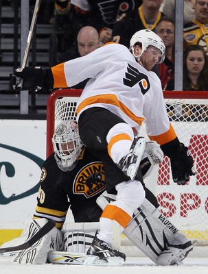 BOSTON, MA - DECEMBER 11:  Scott Hartnell #19 of the Philadelphia Flyers falls over Tim Thomas #30 of the Boston Bruins on December 11, 2010 at the TD Garden in Boston, Massachusetts. The Flyers defeated the Bruins 2-1 in overtime.  (Photo by Elsa/Getty I