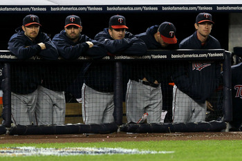 NEW YORK - OCTOBER 09:  Members of the Minnesota Twins look on dejected from the dugout late in the game against the New York Yankees during Game Three of the ALDS part of the 2010 MLB Playoffs at Yankee Stadium on October 9, 2010 in the Bronx borough of