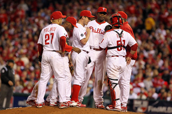 PHILADELPHIA - OCTOBER 23:  Roy Oswalt #44 of the Philadelphia Phillies is met on the mound by Placido Polanco #27, Carlos Ruiz #51 Ryan Howard #6 and Jimmy Rollins #11 against the San Francisco Giants in Game Six of the NLCS during the 2010 MLB Playoffs