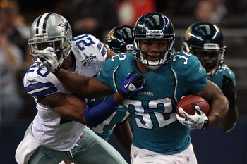 ARLINGTON, TX - OCTOBER 31:  Running back Maurice Jones-Drew #32 of the Jacksonville Jaguars runs the ball past Alan Ball #20 of the Dallas Cowboys at Cowboys Stadium on October 31, 2010 in Arlington, Texas.  (Photo by Stephen Dunn/Getty Images)