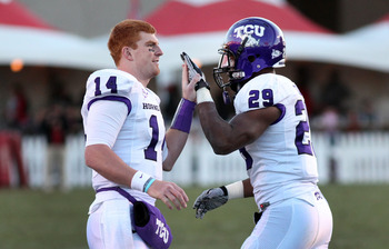 ALBUQUERQUE, NM - NOVEMBER 27: Quarterback Andy Dalton #14 of the TCU Horned Frogs celebrates with running back Matthew Tucker #29 against the University of New Mexico Lobos on November 27, 2010 at University Stadium in Albuquerque, New Mexico. TCU won 66