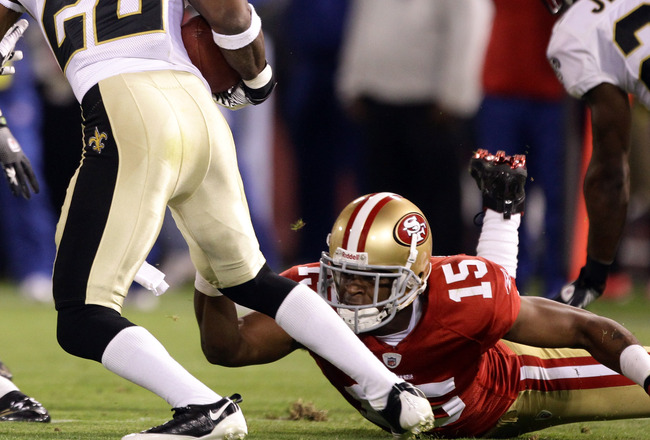 SAN FRANCISCO - SEPTEMBER 20:  Tracy Porter #22 of the New Orleans Saints intercepts a ball intended for Michael Crabtree #15 of the San Francisco 49ers at Candlestick Park on September 20, 2010 in San Francisco, California.  (Photo by Ezra Shaw/Getty Ima
