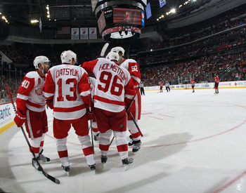 NEWARK, NJ - DECEMBER 11:  Pavel Datsyuk #13 of the Detroit Red Wings is congratulated by Tomas Holmstrom #96 on his goal at 10:26 of the third period against the New Jersey Devils at the Prudential Center on December 11, 2010 in Newark, New Jersey. The R