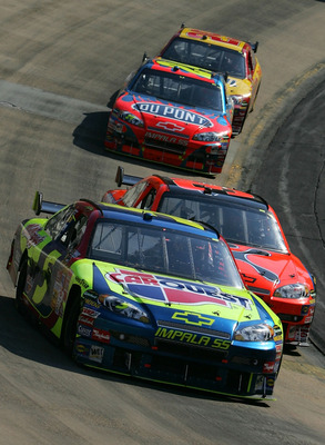 BRISTOL, TN - MARCH 25:  Kyle Busch, driver of the #5 Carquest/Kellogg's Chevrolet, leads Jeff Burton, driver of the #31 Cingular Wireless Chevrolet,  Jeff Gordon, driver of the #24 DuPont Chevrolet, and Kevin Harvick, driver of the #29 Shell/Pennzoil Che