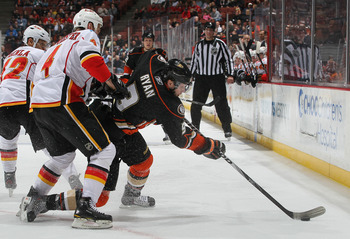 ANAHEIM, CA - DECEMBER 10:  Bobby Ryan #9 of the Anaheim Ducks is pursued by Jay Bouwmeester #4 of the Calgary Flames for the puck in the third period at the Honda Center on December 10, 2010 in Anaheim, California. The Ducks defeated the Flames 3-2 in a