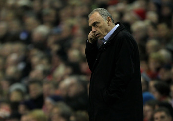 LIVERPOOL, ENGLAND - NOVEMBER 20:  West Ham United Manager Avram Grant watches the action during the Barclays Premier League match between Liverpool and West Ham United at Anfield on November 20, 2010 in Liverpool, England.  (Photo by Alex Livesey/Getty I