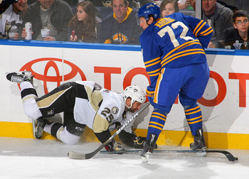 BUFFALO, NY - DECEMBER 11: Maxime Talbot #25 of the Pittsburgh Penguins falls into Luke Adam #72 of the Buffalo Sabres at HSBC Arena on December 11, 2010 in Buffalo, New York.  (Photo by Rick Stewart/Getty Images)