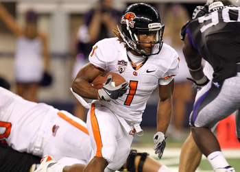 ARLINGTON, TX - SEPTEMBER 04:  Running back Jacquizz Rodgers #1 of the Oregon State Beavers runs against the TCU Horned Frogs in the third quarter at Cowboys Stadium on September 4, 2010 in Arlington, Texas.  (Photo by Ronald Martinez/Getty Images)