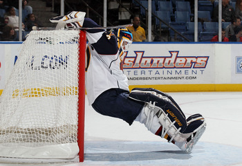 UNIONDALE, NY - DECEMBER 11:  Chris Mason #50 of the Atlanta Thrashers stretches during a time out agianst the New York Islanders looks on on December 11, 2010 at Nassau Coliseum in Uniondale, New York.  (Photo by Jim McIsaac/Getty Images)